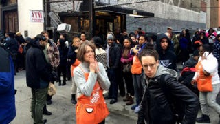 Home Depot employees and customers stand outside the store in the Flatiron district of Manhattan in New York City Jan. 25, 2015, after a man opened fire, killing his supervisor before turning the gun on himself. MSNBC Screenshot