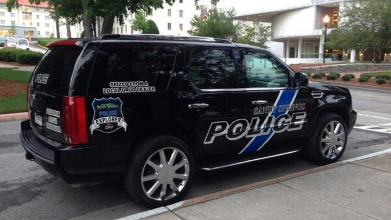 Illustration for article titled Escalade Cop Car 'Seized From A Drug Dealer' Is All Kinds Of Terrible