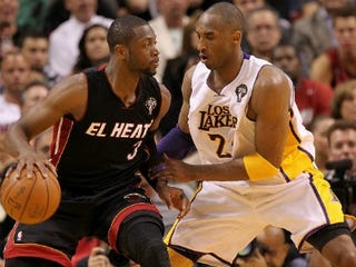 Dwyane Wade (left) and Kobe Bryant (Mike Ehrmann/Getty Images)