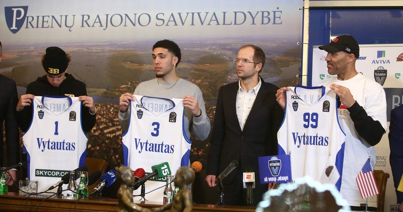 LaVar Ball (right) with his sons LiAngelo (second from left) and LaMelo Ball (left) during a press conference after LiAngelo and LaMelo's first training session with Vytautas Prienai on Jan. 5, 2018, in Prienai, Lithuania (Alius Koroliovas/Getty Images)