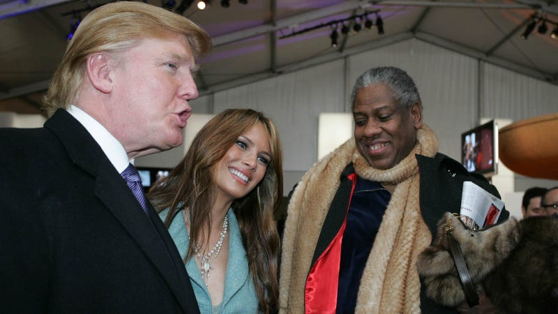 Image of André Leon Talley with Donald Trump and Melania Trump at Fashion Week in 2005 via Getty