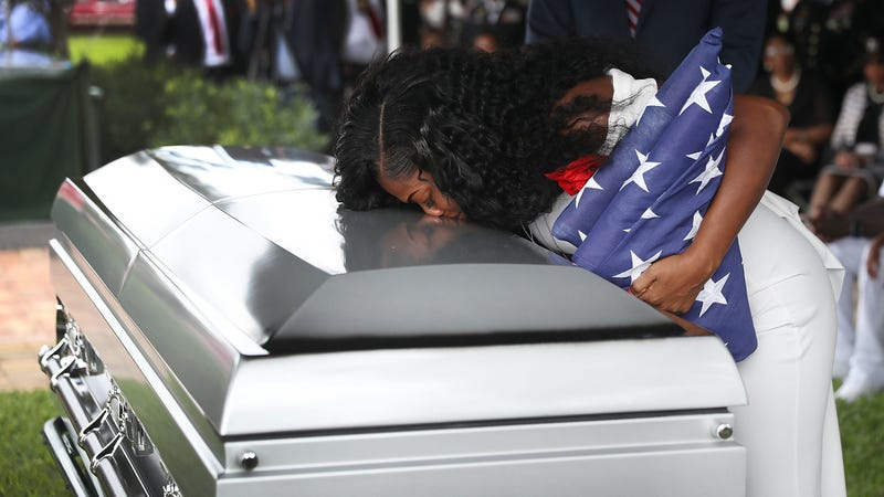Myeshia Johnson kisses the casket of her husband U.S. Army Sgt. La David Johnson during his burial service at the Memorial Gardens East cemetery on October 21, 2017 in Hollywood, Florida. Image via Getty.