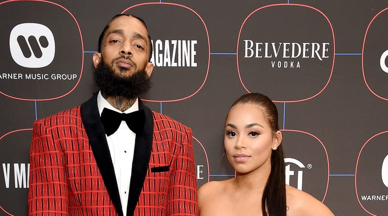 Nipsey Hussle and Lauren London arrive at the Warner Music Group Pre-Grammy Celebration on February 7, 2019 in Los Angeles, California.