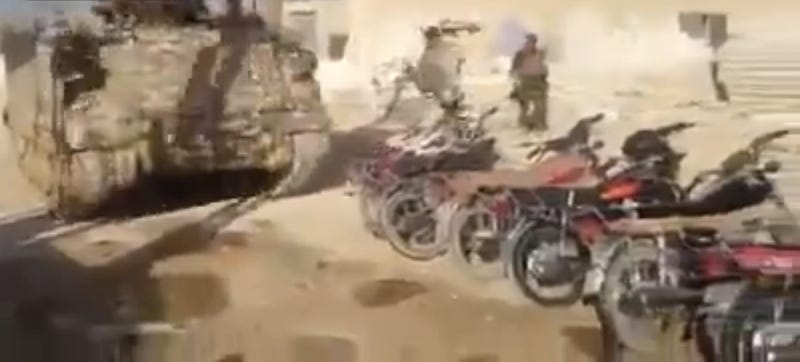 Illustration for article titled Watch The Lebanese Army Drive A Tank Over ISIS Motorcycles