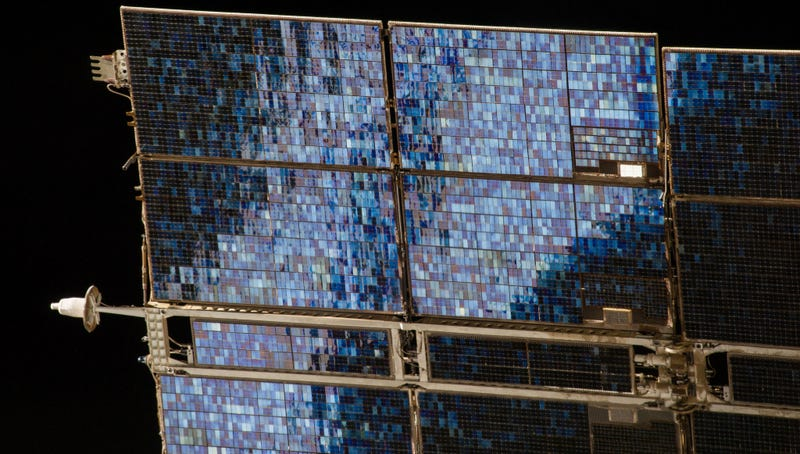 Illustration for article titled Solar Panel is a Glittering Blue Mosaic Against the Blackness of Space