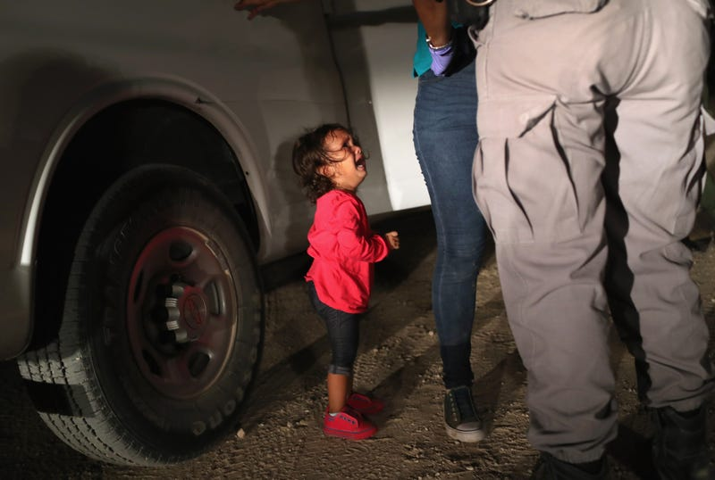 A 2-year-old Honduran child cries as her mother, seeking asylum for them, is searched and detained by U.S. Border Patrol agents near the U.S.-Mexico border on June 12, 2018, in McAllen, Texas.