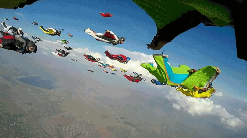 A Flock of 61 Wingsuiters in Flight Looks Like an Airborne Invasion