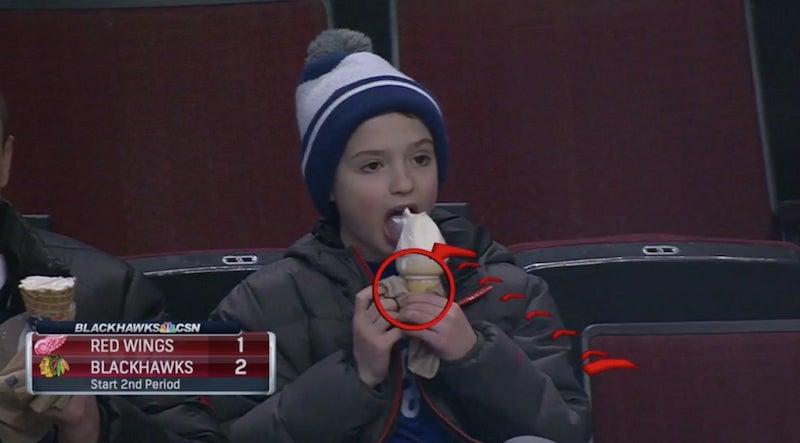 Kid Eating Ice Cream At Hockey Game