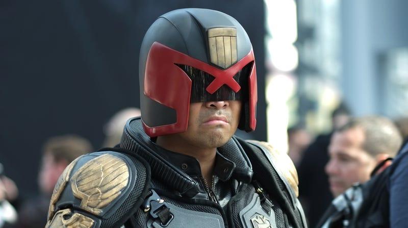 A fan cosplaying as Karl Urban's version of Judge Dredd
