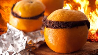 Illustration for article titled Bake a Cake Inside an Orange Peel for a Tasty Campfire Treat