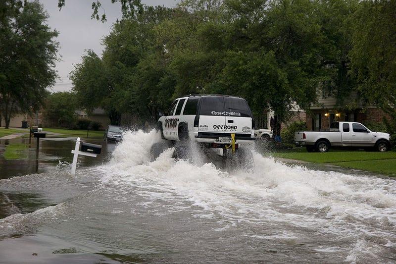 Turn around don 39 t drown houston street flooding mega gallery for Mega motors houston tx