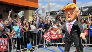 "Onlookers yell at a Donald Trump piñata during a ""Take It Out on Trump"" event in East Los Angeles in September 2015. Mel Melcon/Los Angeles Times"