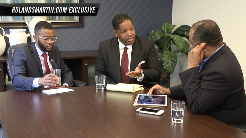 Tyrone Hankerson Jr.; his attorney, James Walker; and Roland Martin