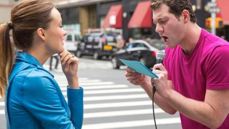 Billy Eichner showing his typical enthusiasm while talking to Olivia Wilde