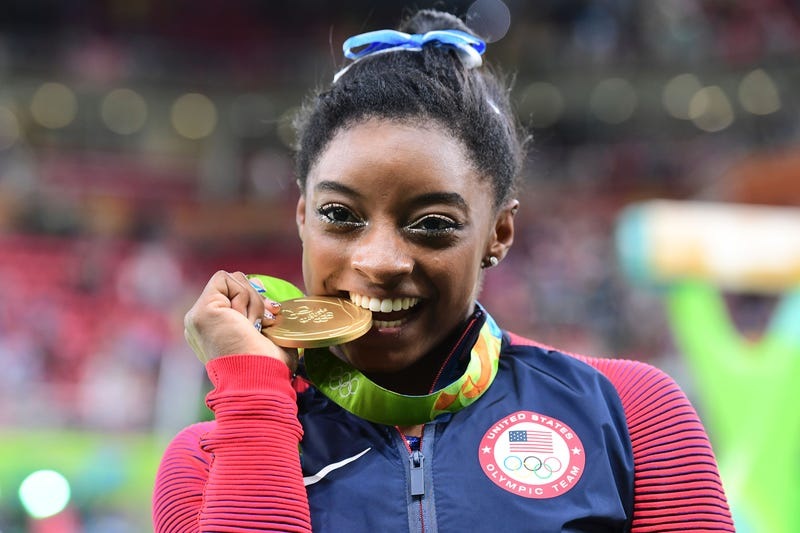 Simone Biles celebrates with her gold medal after the women's individual all-around final of the Rio 2016 Olympic Games in Rio de Janeiro on Aug. 11, 2016.EMMANUEL DUNAND/AFP/Getty Images