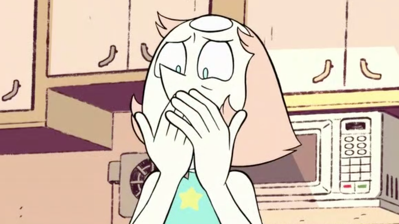 Pearl clutching her face in horror.