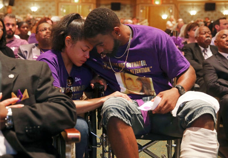 Marcus Martin (right) hugs his fiancee, Marissa Blair, during a memorial for Heather Heyer at the Paramount Theater on Aug. 16, 2017, in Charlottesville, Va.
