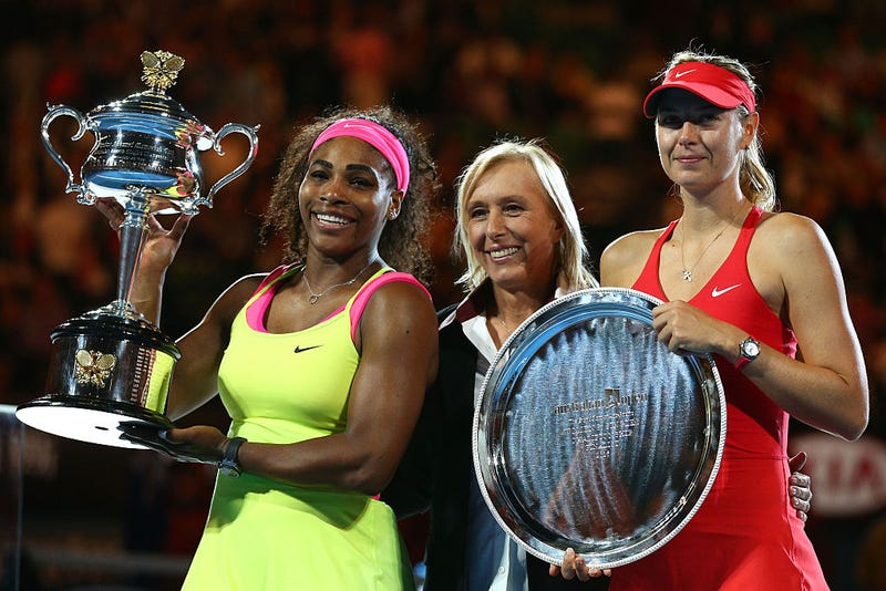 Serena Williams, holding the Daphne Akhurst Memorial Cup, with Martina Navratilova and Maria Sharapova, whoholds the runner-up plate, after their women's finals match at the Australian Open at Melbourne Park  on Jan. 31, 2015. (Cameron Spencer/Getty Images)