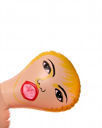 Illustration for article titled Blow-up Sex Doll Causes Car Accident
