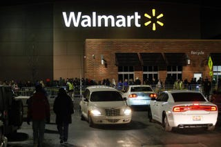 Customers wait in line to enter Walmart Thanksgiving Day, Nov. 28, 2013, in Troy, Michigan.Joshua Lott/Getty Images