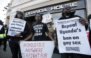 Protesters speak out against gay ban in front of Ugandan police station.