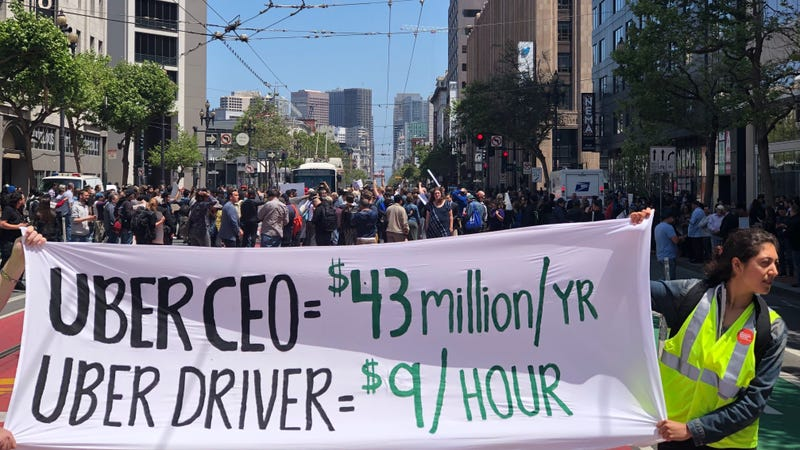 Protesters take over Market Street to demonstrate in front of Uber's San Francisco headquarters.
