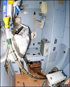 "Illustration for article titled ""Out of Order"" Sign Graces ISS Toilet As 13 Cramped Spacefarers Share Two Stalls"