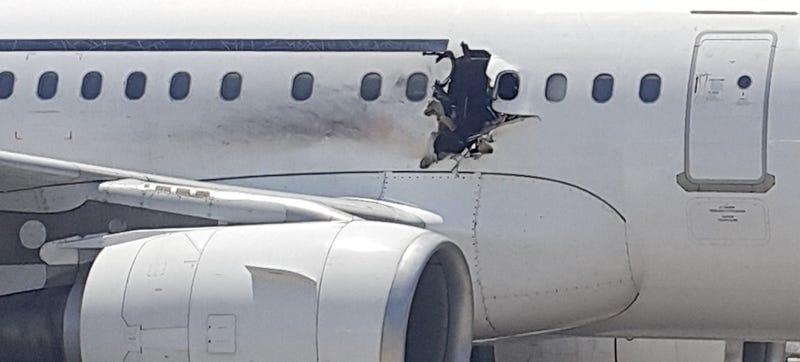 Illustration for article titled Airplane Makes Safe Landing Despite Having Huge Hole Blown in Fuselage