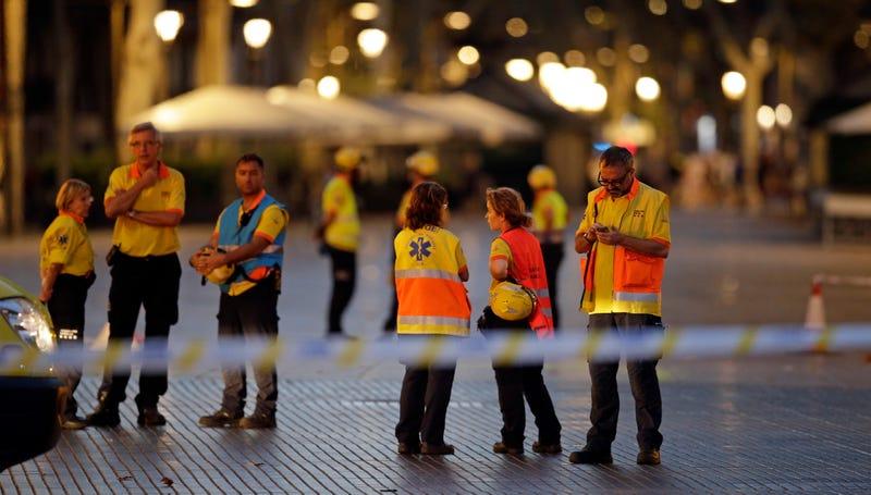 Photo: AP, emergency workers in Barcelona