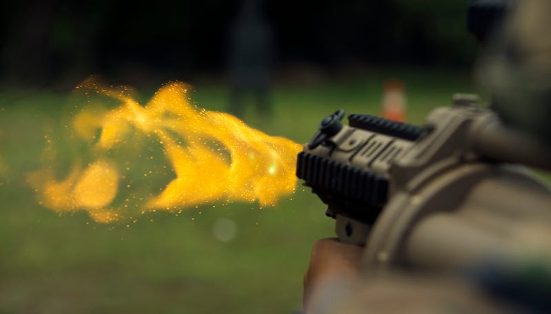 Illustration for article titled The golden glittery fireworks of a grenade launcher captured in a photo