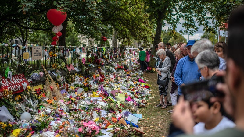 People view flowers and tributes by the botanical gardens on March 19, 2019 in Christchurch, New Zealand