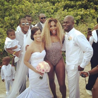 Serena Williams (C) with the wedding party she crashed in Miami May 31, 2014.Serena Williams/Instagram