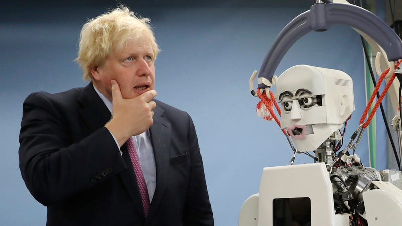 Boris Johnson in 2017 next to a robot for some fucking reason