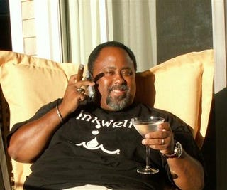 Lawrence Bobo relaxing with a martini and cigar.