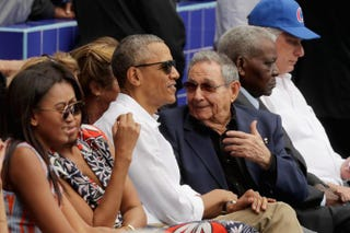 Sasha Obama, first lady Michelle Obama, President Barack Obama and Cuban President Raúl Castro attend an exhibition game between the Cuban national baseball team and Major League Baseball's Tampa Bay Rays at the Estado Latinoamericano on March 22, 2016, in Havana. Chip Somodevilla/Getty Images