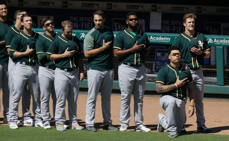 Oakland Athletics catcher Bruce Maxwell takes a knee during the national anthem before a baseball game against the Texas Rangers in Arlington, Texas, on Oct. 1, 2017. (L.M. Otero/AP Images)