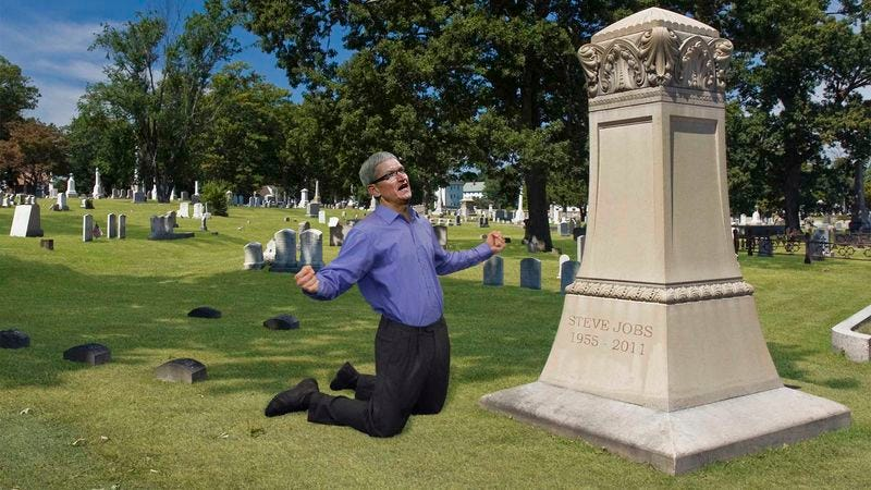 Illustration for article titled Weeping Tim Cook Spotted Screaming For Help At Steve Jobs' Tombstone