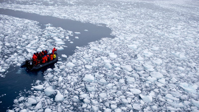 A team of researchers wade through melting Antarctic ice on January 22nd, 2015. Image: AP Photo/Natacha Pisarenko