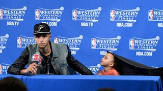 Stephen Curry and daughter Riley Curry at a recent press conference.YOUTUBE SCREENSHOT