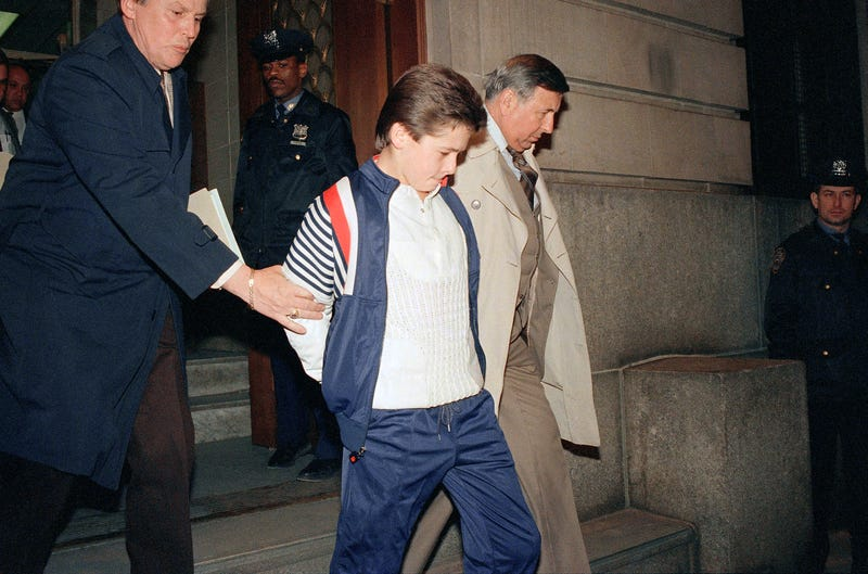 "John Lester, 17, is led from the 106th Precinct in Queens, N.Y., on Dec. 23, 1986, after being charged with murder in what then-New York City Mayor Ed Koch referred to as a ""racial lynching.""  (David Bookstaver/AP Images)"