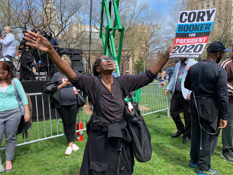 Dorothy Raines, of Newark, reacting to stage music as she waits for U.S. Senator and presidential candidate Cory Booker to take the stage for his hometown presidential campaign celebration on April 13, 2019.