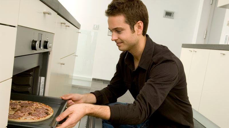 Illustration for article titled Man Pours All His Culinary Talents Into Inserting, Removing Pizza From Oven