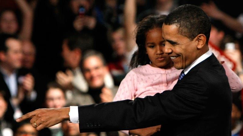 Democratic presidential candidate Sen. Barack Obama (D-IL) holds his youngest daughter Sasha while thanking supporters for his victory in the Iowa caucus January 3, 2008 in Des Moines, Iowa