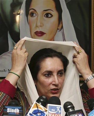 Illustration for article titled Benazir Bhutto Adjusts Scarf In Front Of Own Likeness