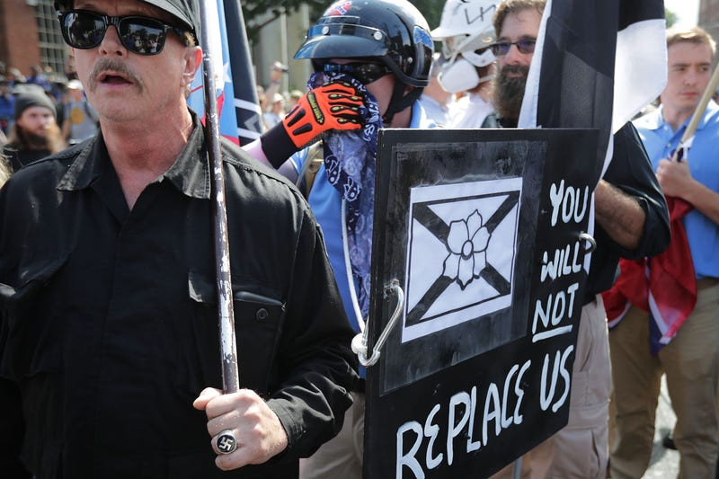 """Hundreds of white nationalists, neo-Nazis and members of the """"alt-right"""" march down East Market Street toward Emancipation Park during the Unite the Right rally Aug. 12, 2017, in Charlottesville, Va. (Chip Somodevilla/Getty Images)"""