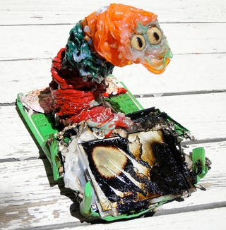 Illustration for article titled Microwaved OLPC Gets Molded Into a Scary Sushi Slug