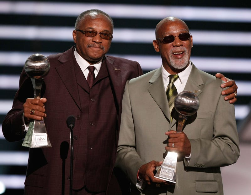 Tommie Smith, left, and John Carlos accept the Arthur Ashe Award for Courage as they were given the award for their black-gloved fist salute at the 1968 Mexico City Olympics onstage at the 2008 ESPY Awards held at NOKIA Theatre L.A. on July 16, 2008 in Los Angeles, California.