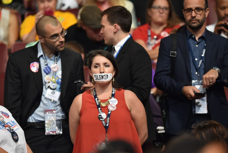 A supporter of former Democratic presidential candidate Bernie Sanders stands in silent protest during Day 1 of the Democratic National Convention at the Wells Fargo Center in Philadelphia July 25, 2016. NICHOLAS KAMM/AFP/Getty Images