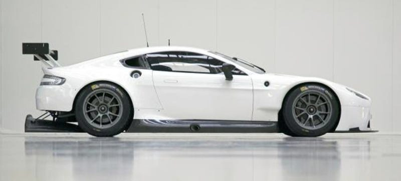 Illustration for article titled An Aston Martin With A Dinner Table Hanging Under Its Rear End Means Business