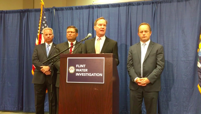 Michigan Attorney General Mike Schuette at a press conference this morning. Image via screenshot/The Detroit News.